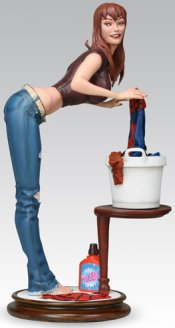 Mary-Jane bends over some laundry, the statue.